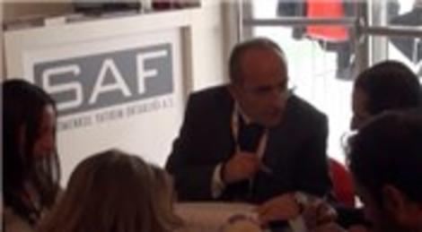 Ömer Faruk Çelik, MIPIM 2013 Fuarı'nda Ali Babacan'a konut sektörü raporunu sundu!