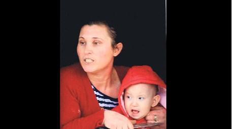 kaçak ev yıkımı sırasında bebeğinin boğazına bıçak dayayan anne
