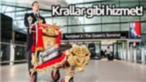 Kraliçe Terminali'nde altın kaplama bagaj arabası