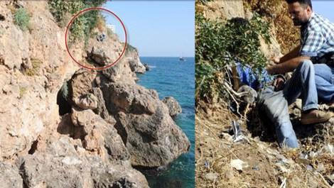 Antalya'da kayalıklara düşen inşaat işçisini itfaiye kurtardı