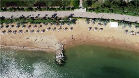 Marmara'da deniz sezonu açıldı, tatilciler Armutlu'ya akın etti